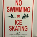No swimming or ice skating sign for outdoor bodies of water