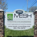 Carved wood sign for MESH Consulting in Eagleville, PA