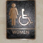 Two toned bronze cast ADA restroom sign for a project in Exton, PA