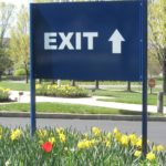 Directional aluminum post and panel sign with vinyl graphics