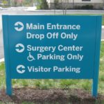 Painted aluminum post and panel directional sign with vinyl graphics