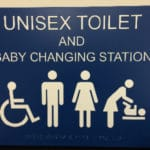 Unisex Bathroom ADA Sign with rasters for ferry boat in Seattle, Washington