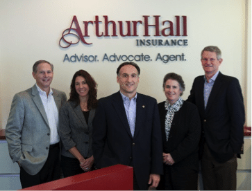 Management team at Arthur Hall with the updated reception signage with dimensional letters